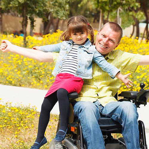 Father Daughter Wheelchair Mary Kay Hansen Law